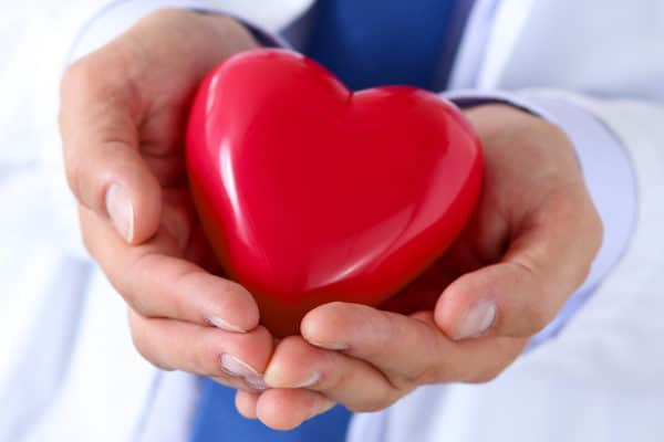 Psychologist holding toy heart in hands - American Behavioral Clinics of WI